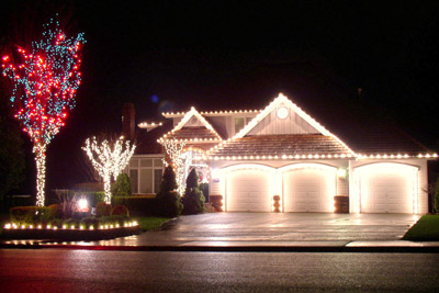 Beautiful Christmas lights decorated along home and landscape. Boulder Falls Inc. is your local Christmas lights installer in the Clark County area.